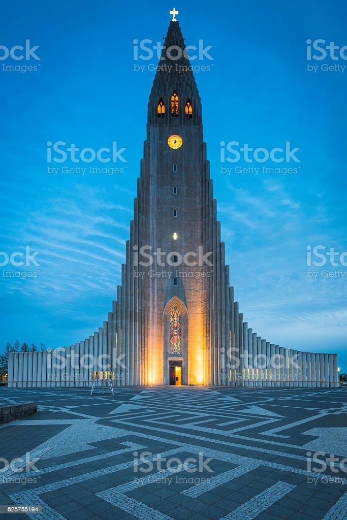 Reykjavik cathedral Hallgrimskirkja iconic church illuminated at sunset Iceland stock photo