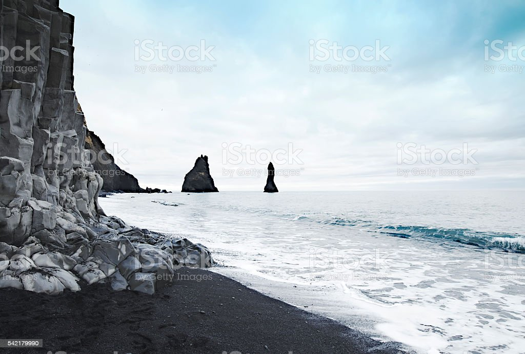 Reynisdrangar basalt colums in the sea near Vik,Iceland stock photo