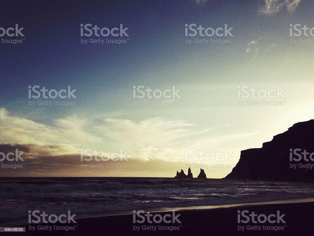 Reynisdrangar basalt sea stacks at sunset in Vik,Iceland stock photo