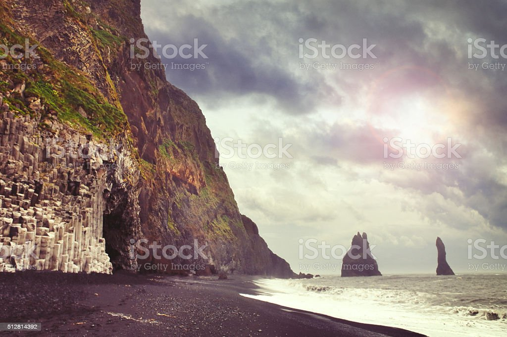 Reynisdrangar cliffs by the town Vik in Iceland stock photo