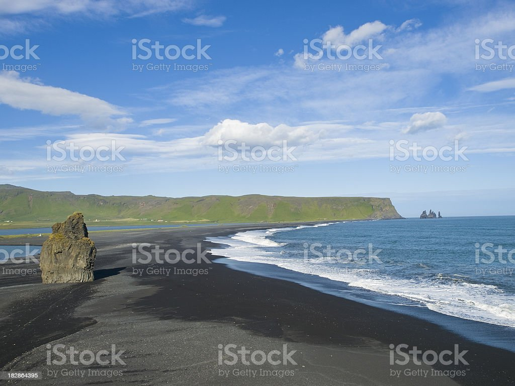 Reynisdrangar from Dyrholaey, Iceland. stock photo