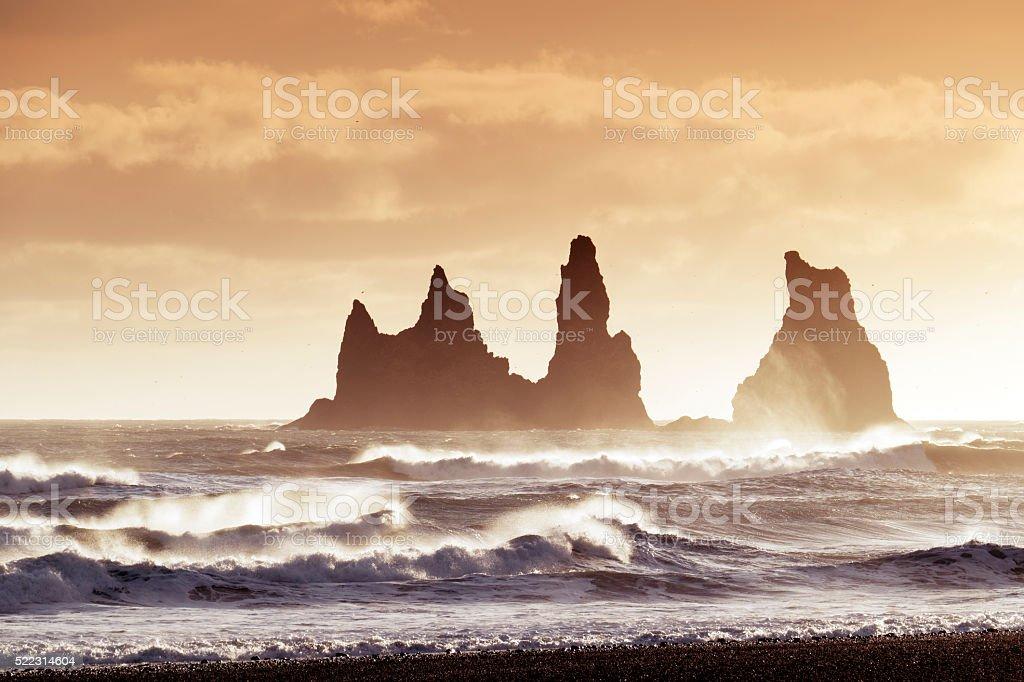 Reynisdrangar sea stacks in  Atlantic Ocean at sunset,Vik,Iceland stock photo