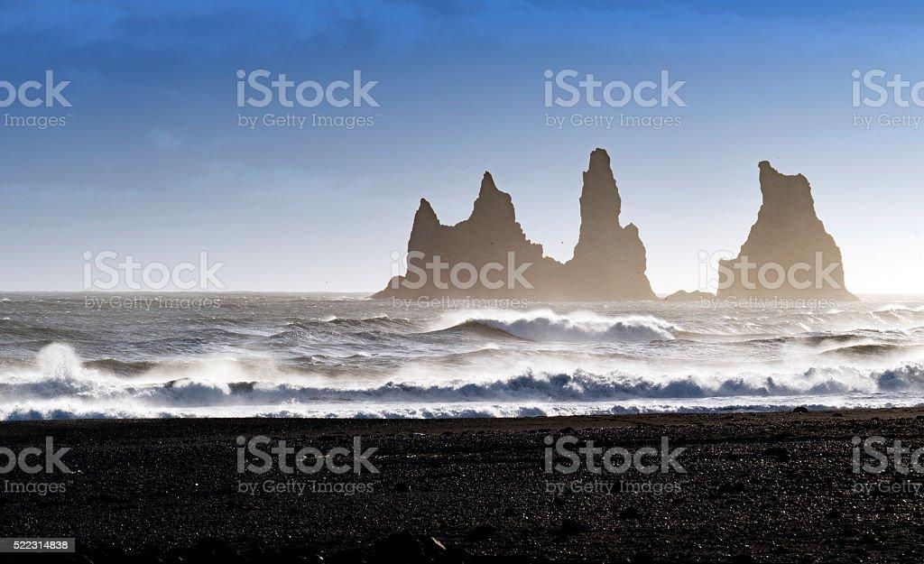 Reynisdrangar sea stacks in  rough Atlantic Ocean ,Vik,Iceland stock photo