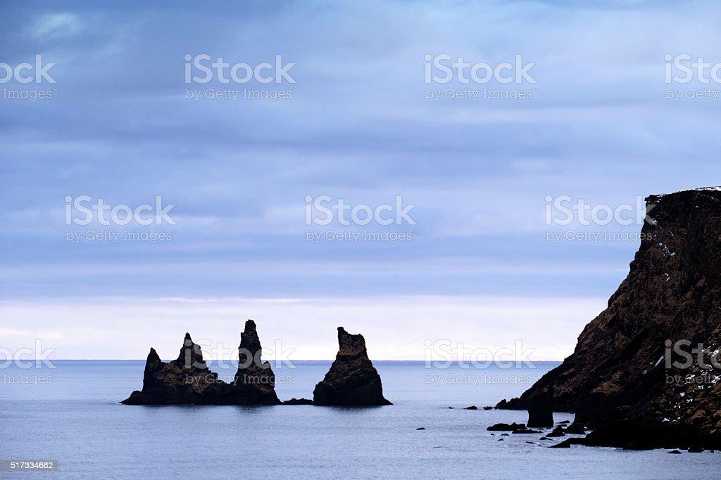 Reynisdrangar sea stacks in the Atlantic Ocean at stock photo