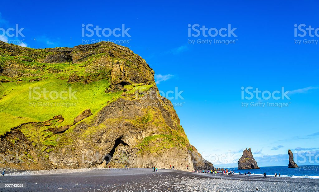 Reynisfjall Mountain at the black sand beach of Reynisfjara - stock photo