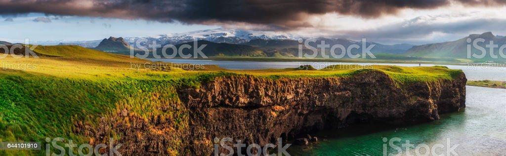 Reynisfjara black sand beach in Iceland. Reynisfyal Mountains stock photo