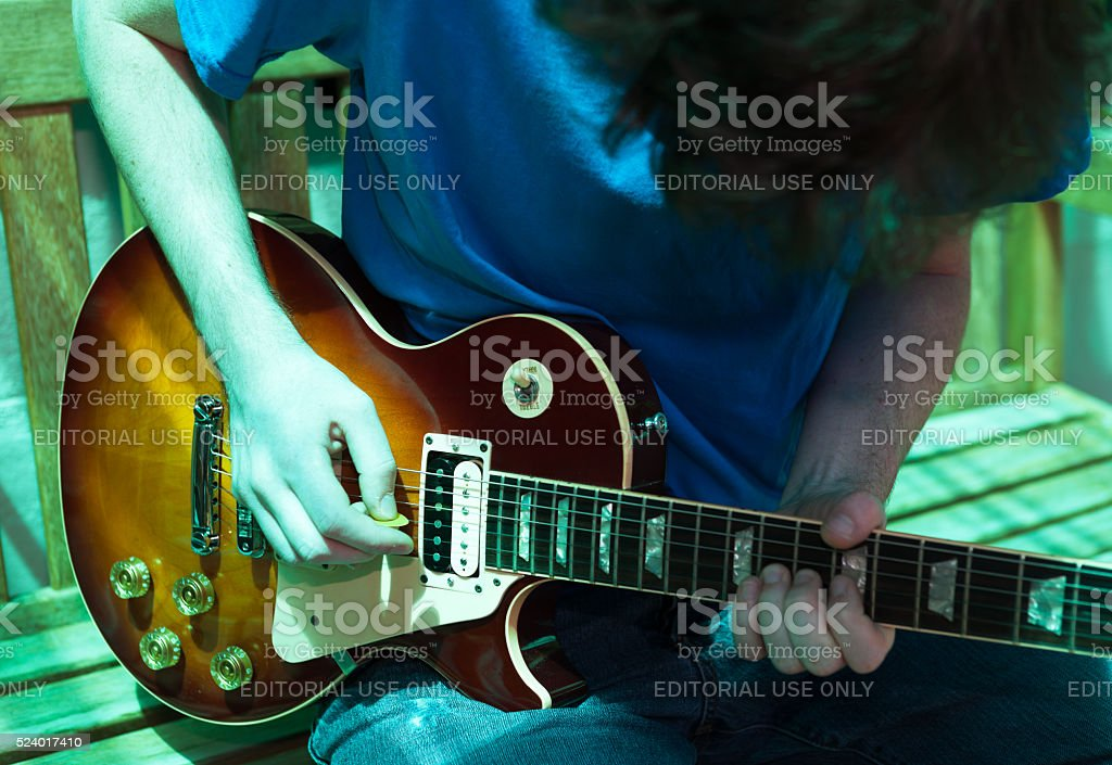 Rhapsody in Blue: young guitarist playing Gibson Les Paul Standard stock photo