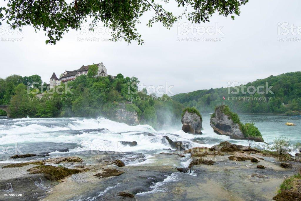 Rheinfall landscape and Schloss Laufen on hill. stock photo
