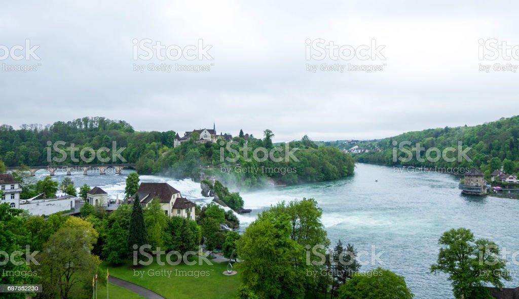 Rheinfall landscape. Schloss Laufen on hill, bridge, Worth castle and buildings nearby. stock photo
