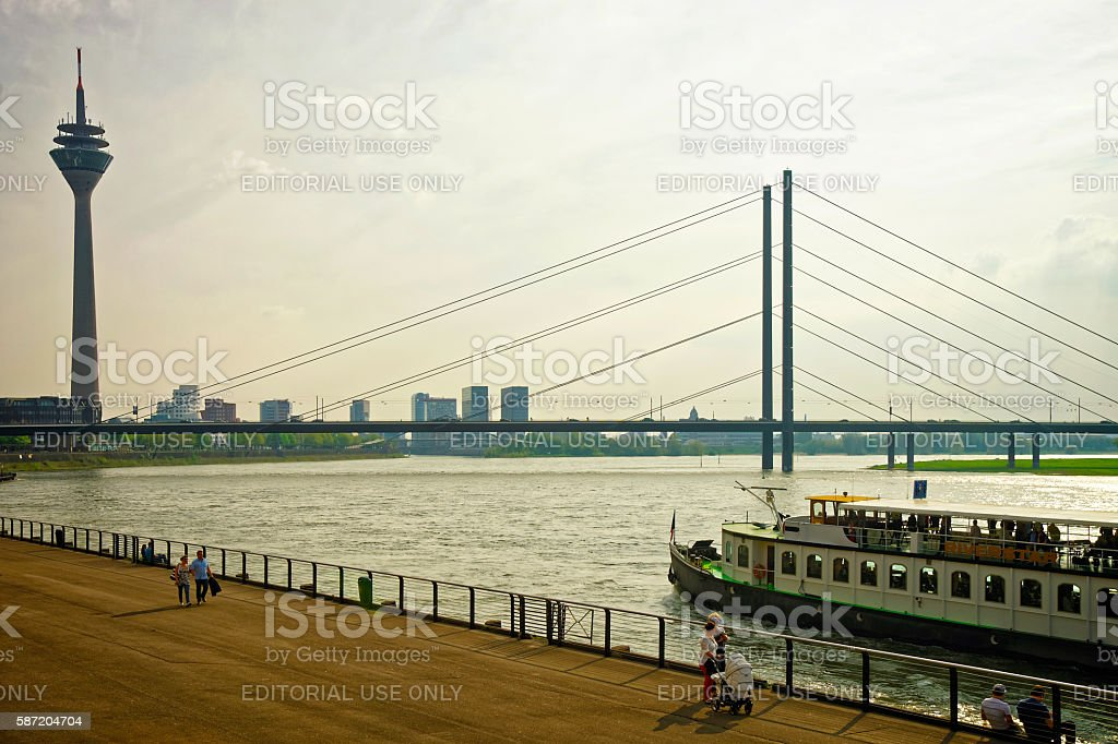 Rheinturm Tower and Rhine embankment promenade in Dusseldorf stock photo