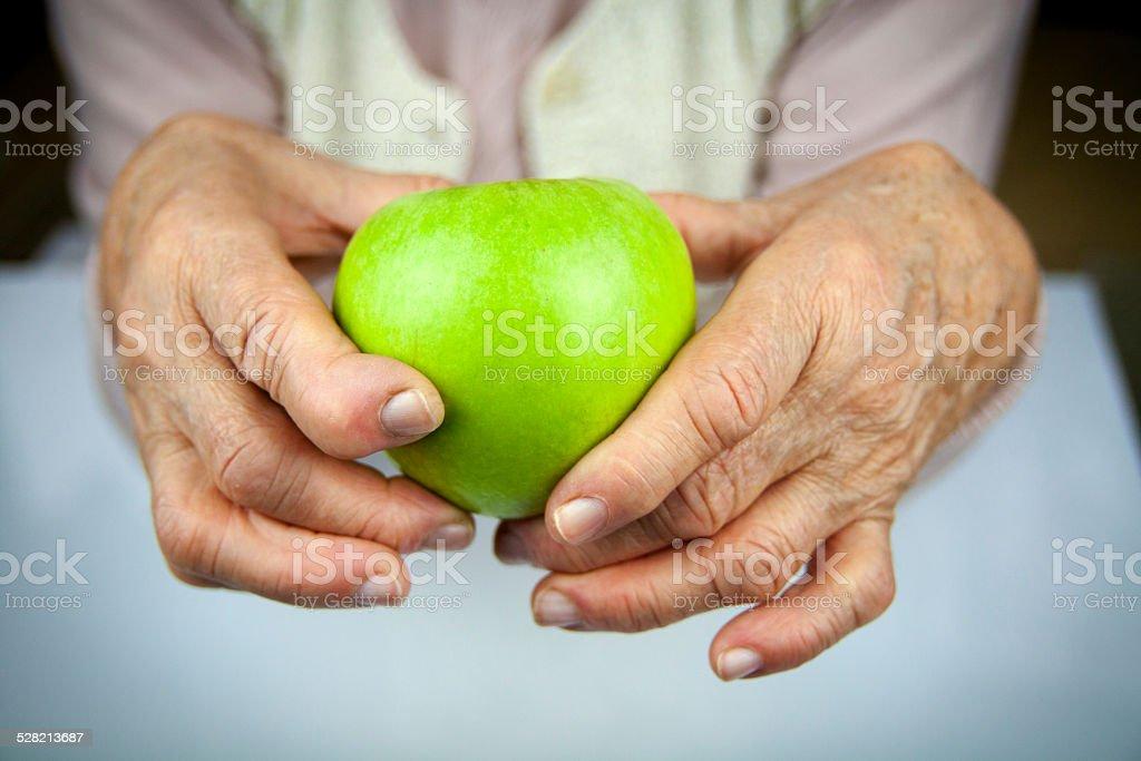 Rheumatoid arthritis hands and fruits stock photo