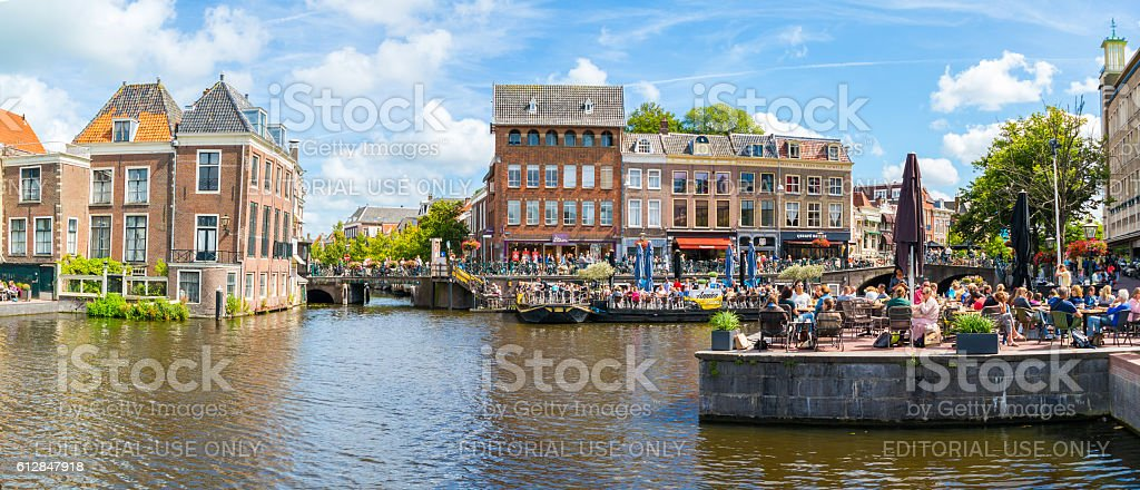 Rhine canal with people and old gables, Leiden, Netherlands stock photo