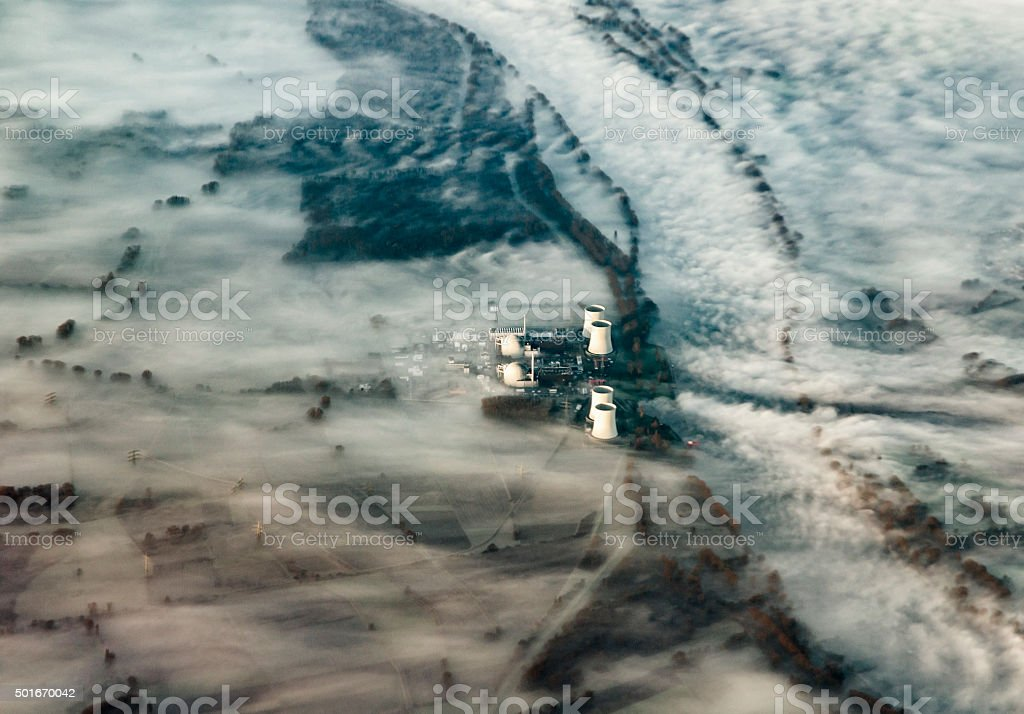 Rhine valley Landscape in  fog with power plant stock photo
