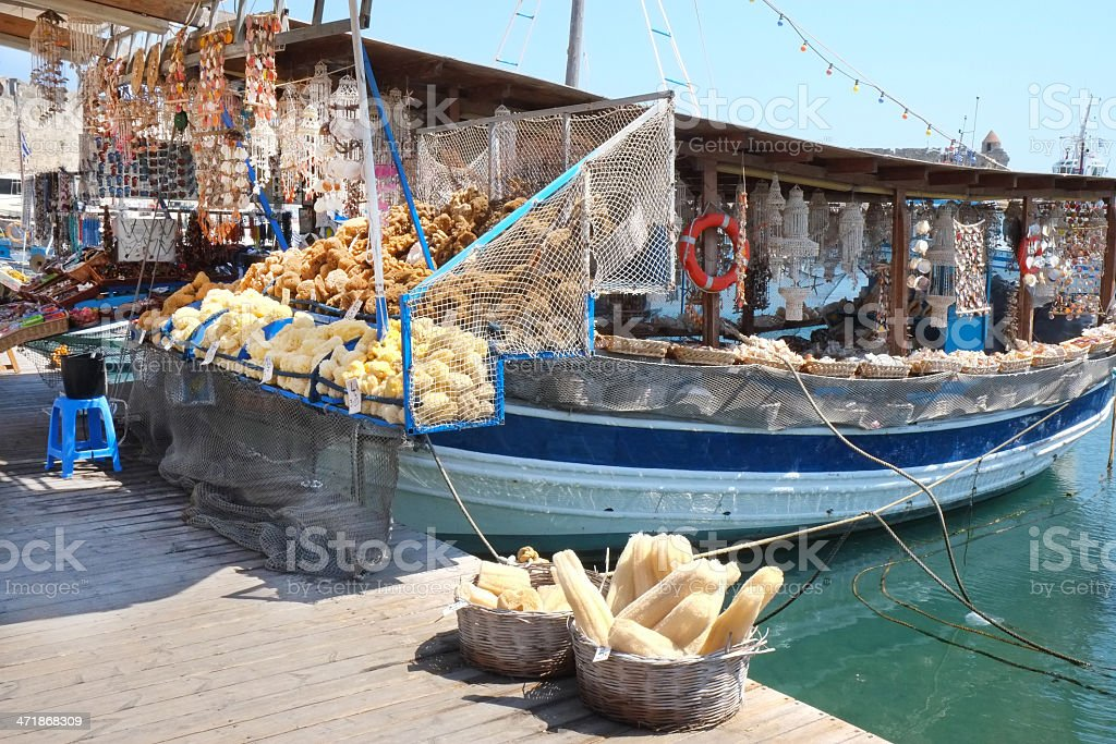 Rhodes harbour boat selling shells and sponges royalty-free stock photo