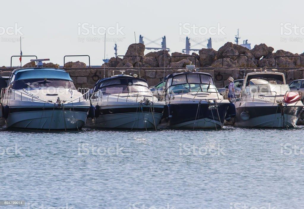 Rhodes island landmark, Mandraki Port, Greece. four luxury white large yacht at anchor stock photo