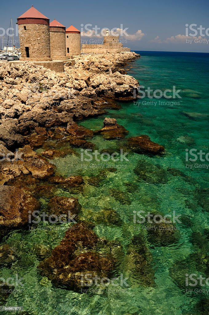 Rhodes Mandraki – windmills and lighthouse stock photo