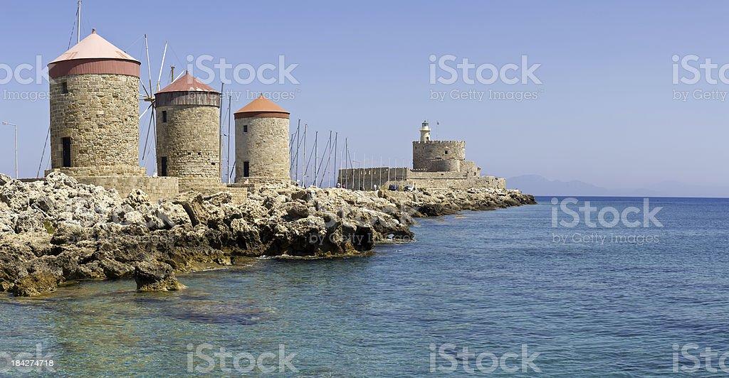 Rhodes Mandraki Windmills / Lighthouse royalty-free stock photo