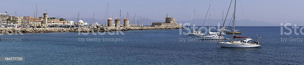 Rhodes Mandraki Windmills / Lighthouse stock photo