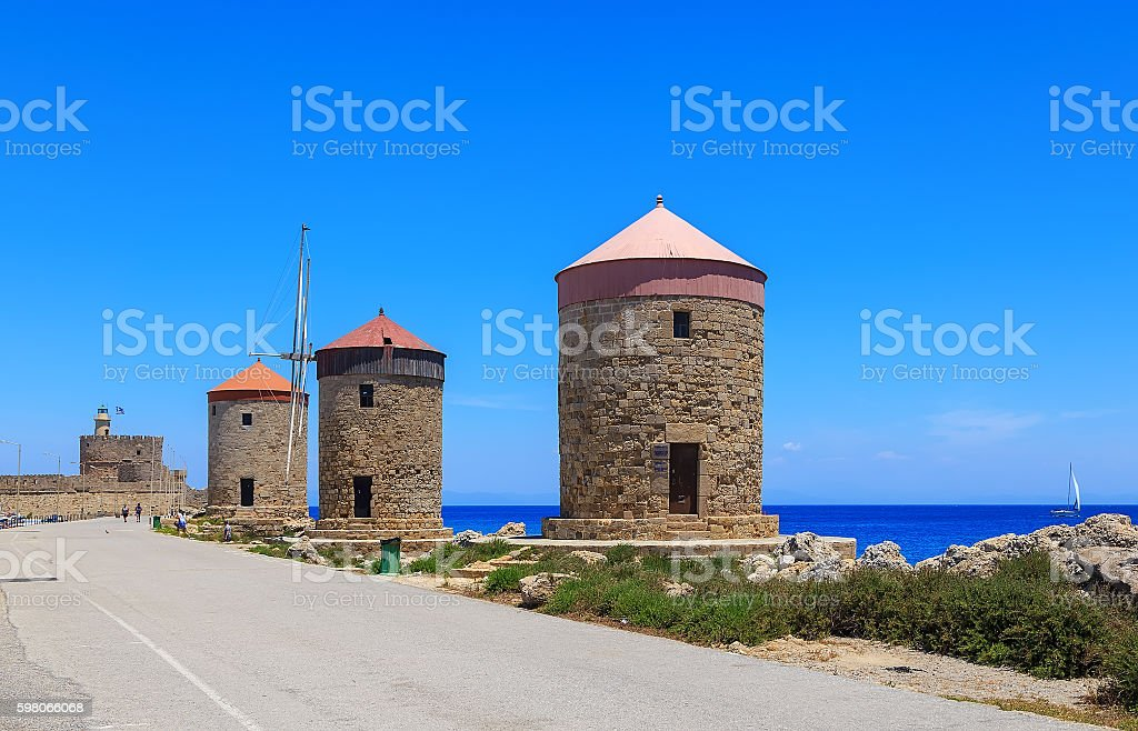 Rhodes mills on background of sea bay and port stock photo