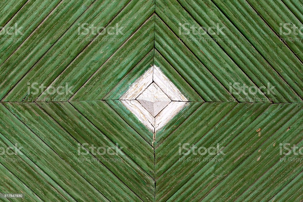 Rhomb pattern of the old painted wooden gate. stock photo