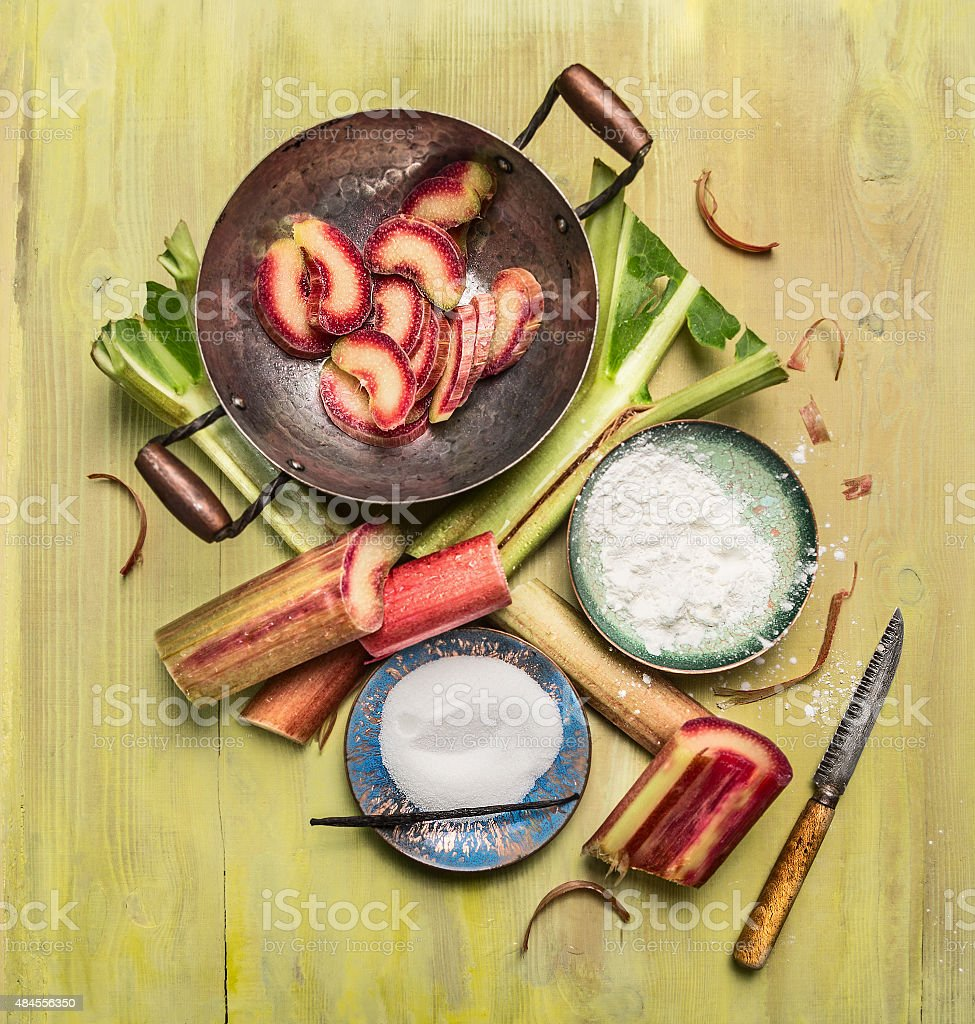 rhubarb preparation of making jam on rustic wooden background stock photo