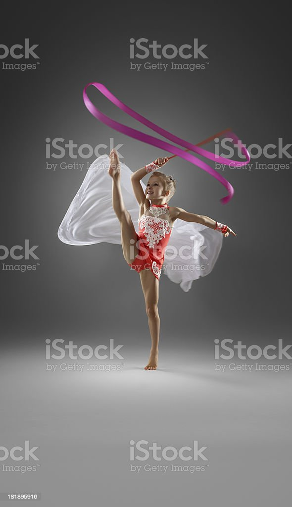Rhythmic gymnastics, girl doing routine with ribbon royalty-free stock photo