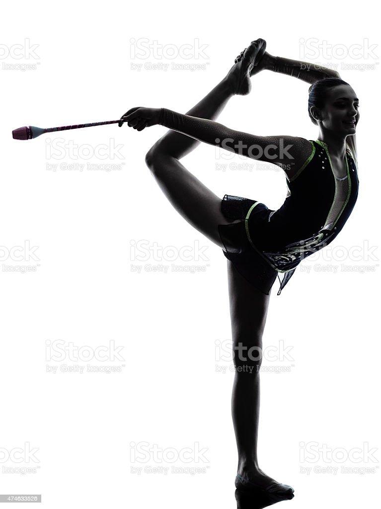 Rhythmic Gymnastics teeenager girl woman silhouette stock photo