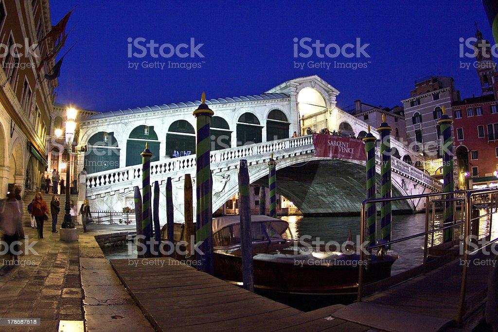 Rialto bridge by night in Venice royalty-free stock photo