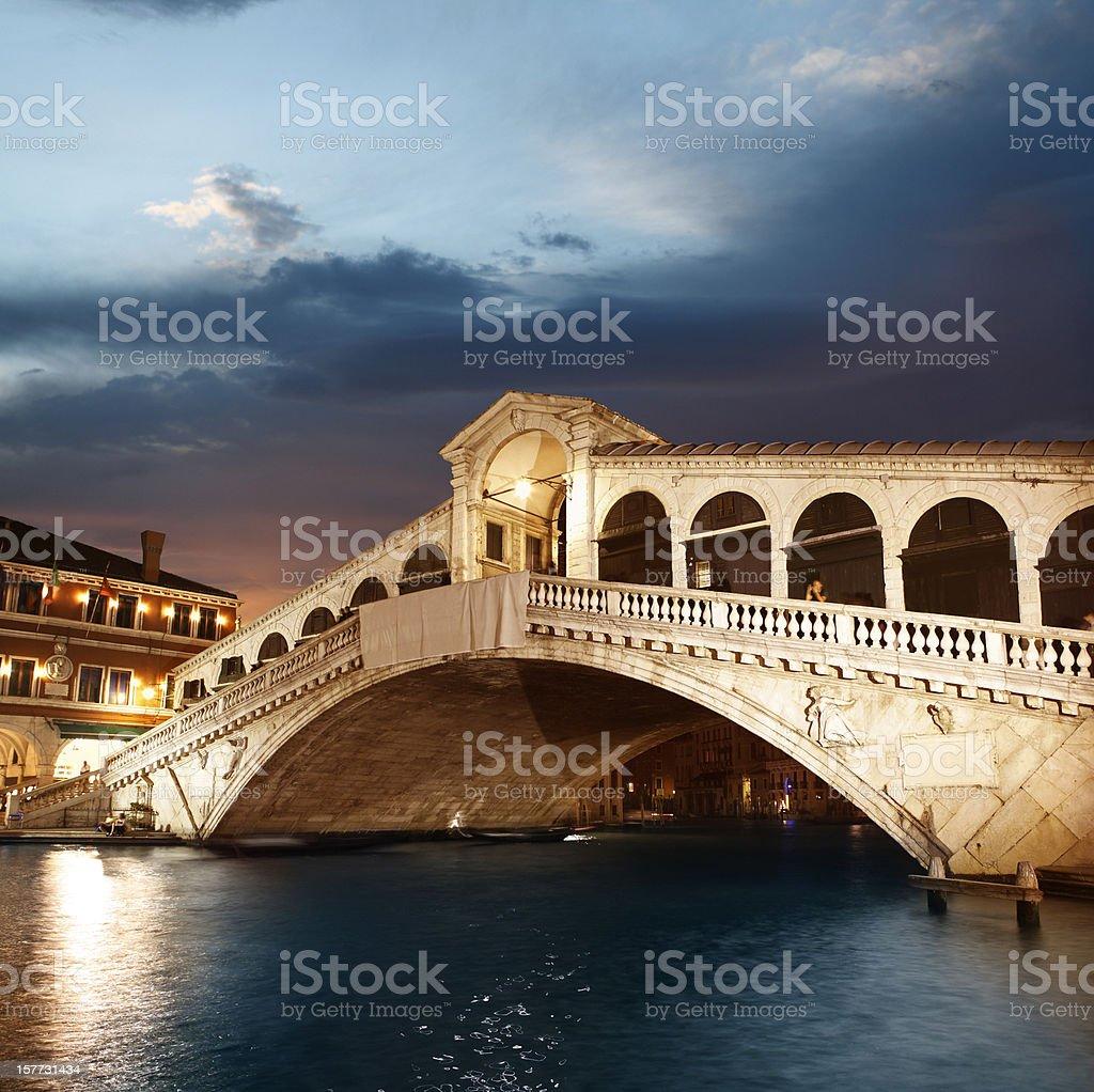 Rialto Bridge in Venice by twilight stock photo