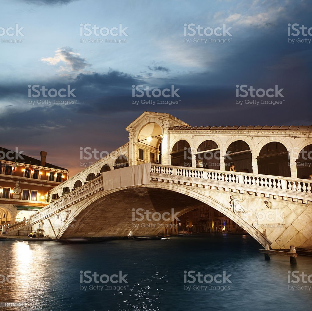 Rialto Bridge in Venice by twilight stock photo
