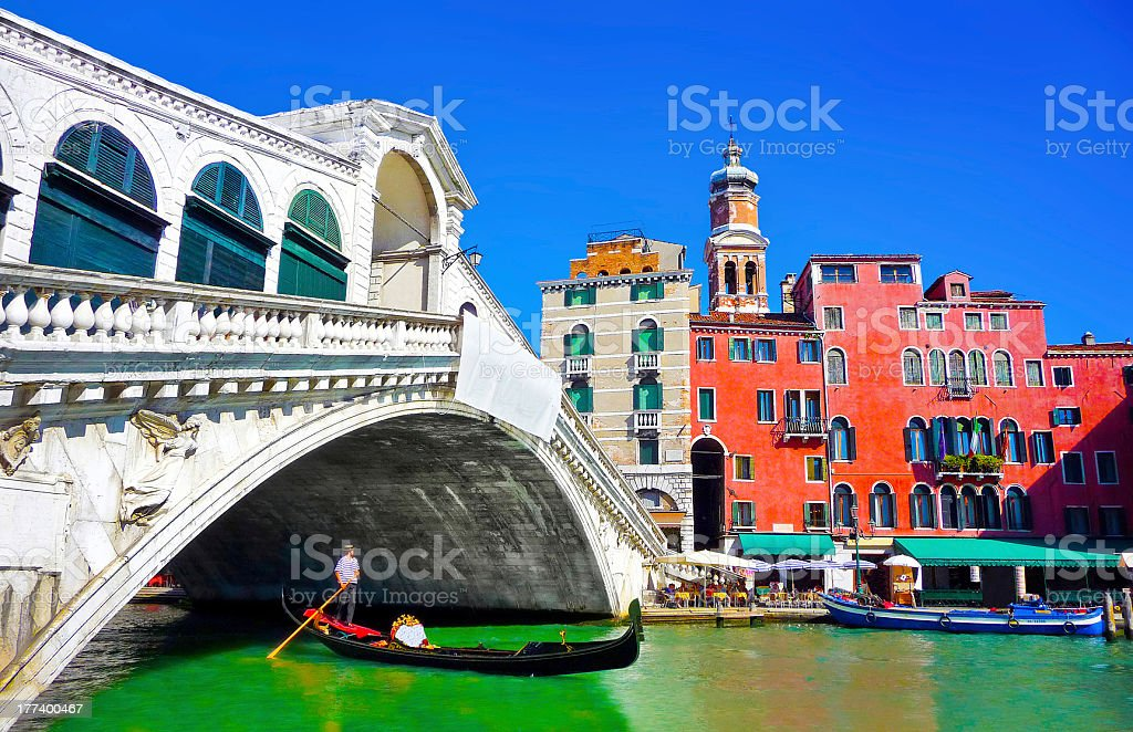 Rialto Bridge with Gondola on Canal Grande in Venice, Italy royalty-free stock photo