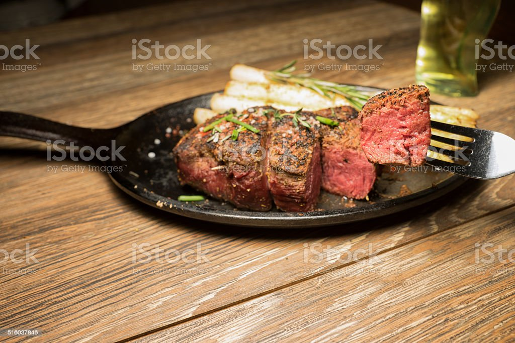 Rib Beef Steak Medium Rare with Bite Cut Out stock photo