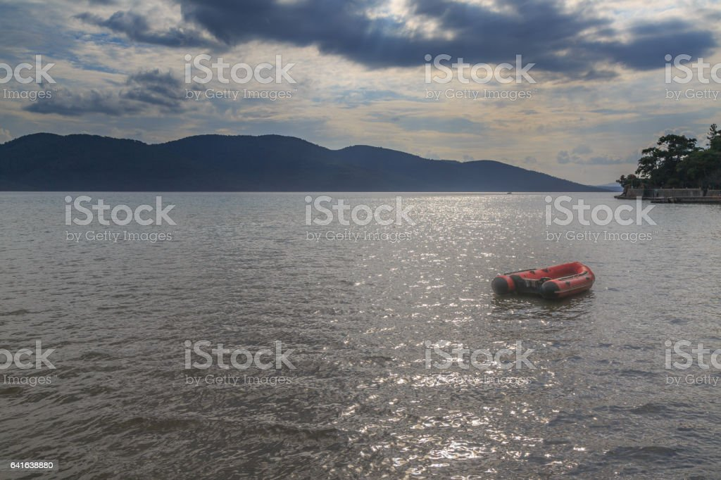 Rib boat in the sea with mountains background. stock photo