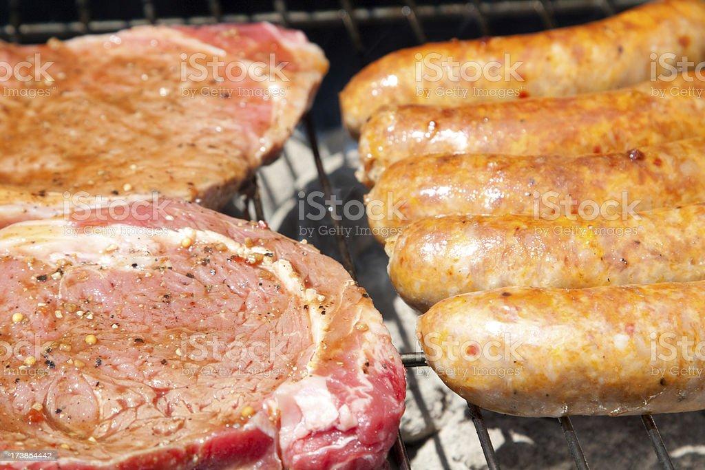 Rib eye Steak and Sausage royalty-free stock photo