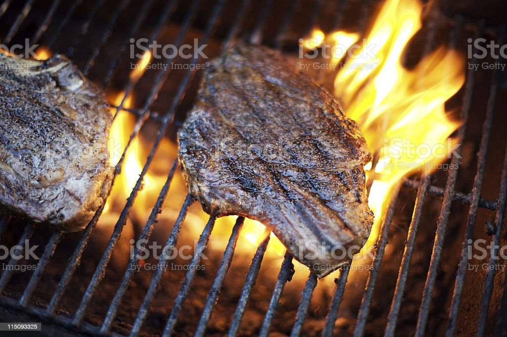 rib eye steak flames royalty-free stock photo