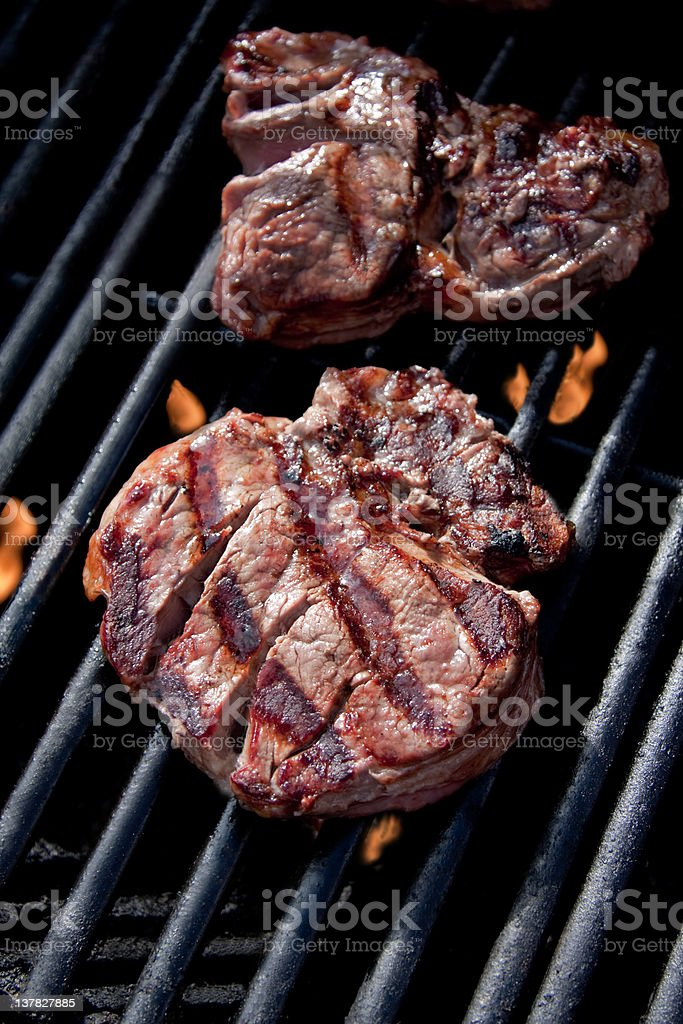 Rib Eye steak on a barbeque grill royalty-free stock photo