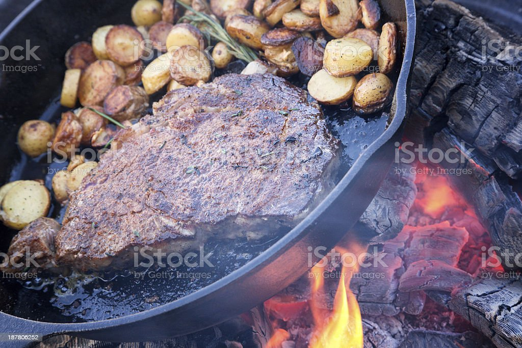 Rib Eye Steak on Campfire royalty-free stock photo