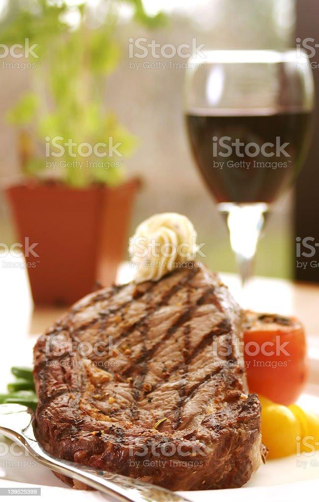 Rib Eye Steak served with wine stock photo