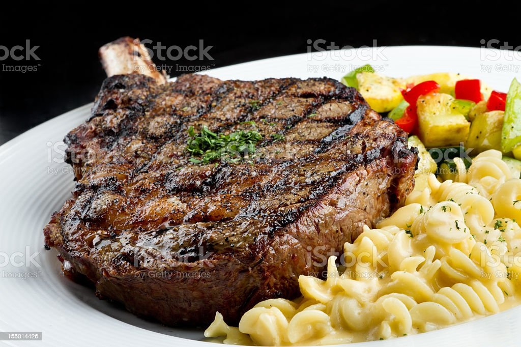 Rib Eye Steak with Macaroni and Cheese royalty-free stock photo
