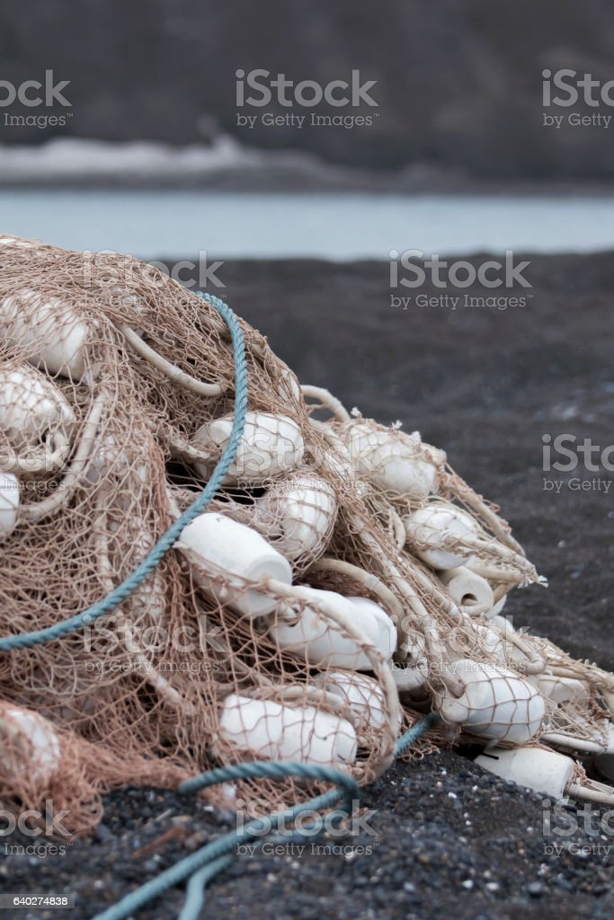 rib of a whale lies on fishing net with floats stock photo