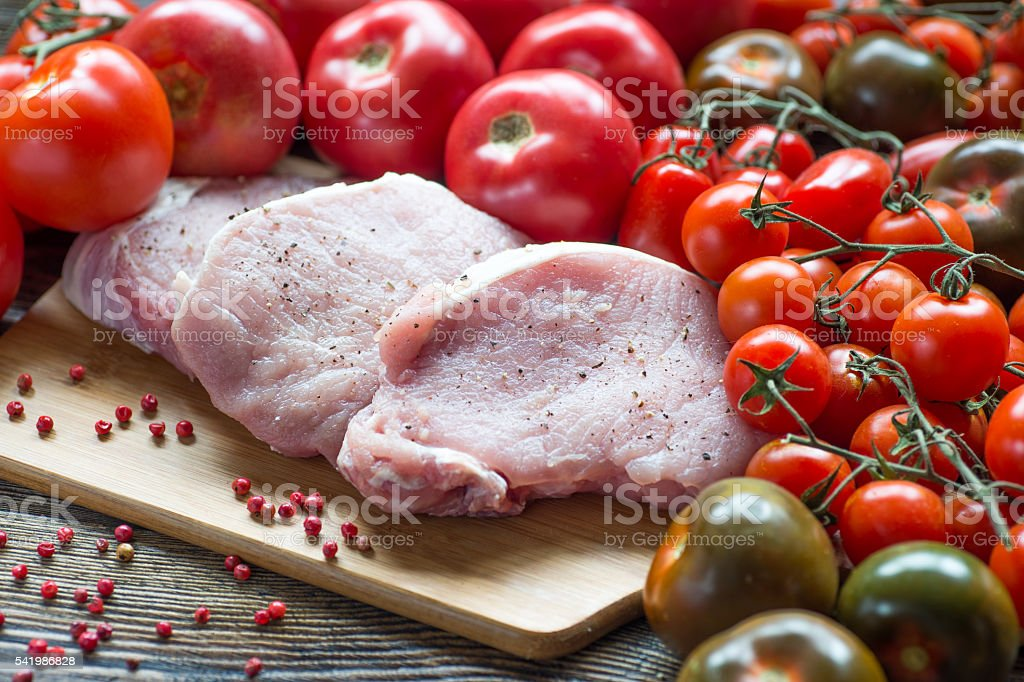 Rib pork chops meat prime cut with tomatos stock photo