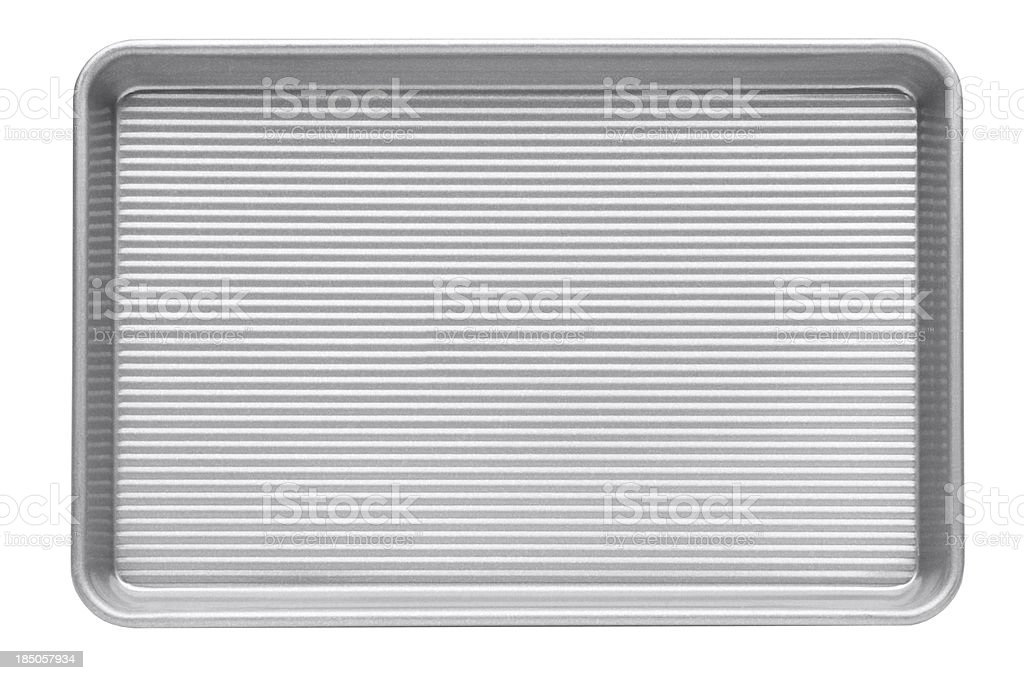 Ribbed aluminum cookie sheet on a white background stock photo