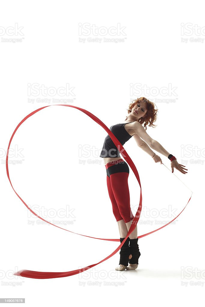 A ribbon dancer with a red ribbon and pants  stock photo