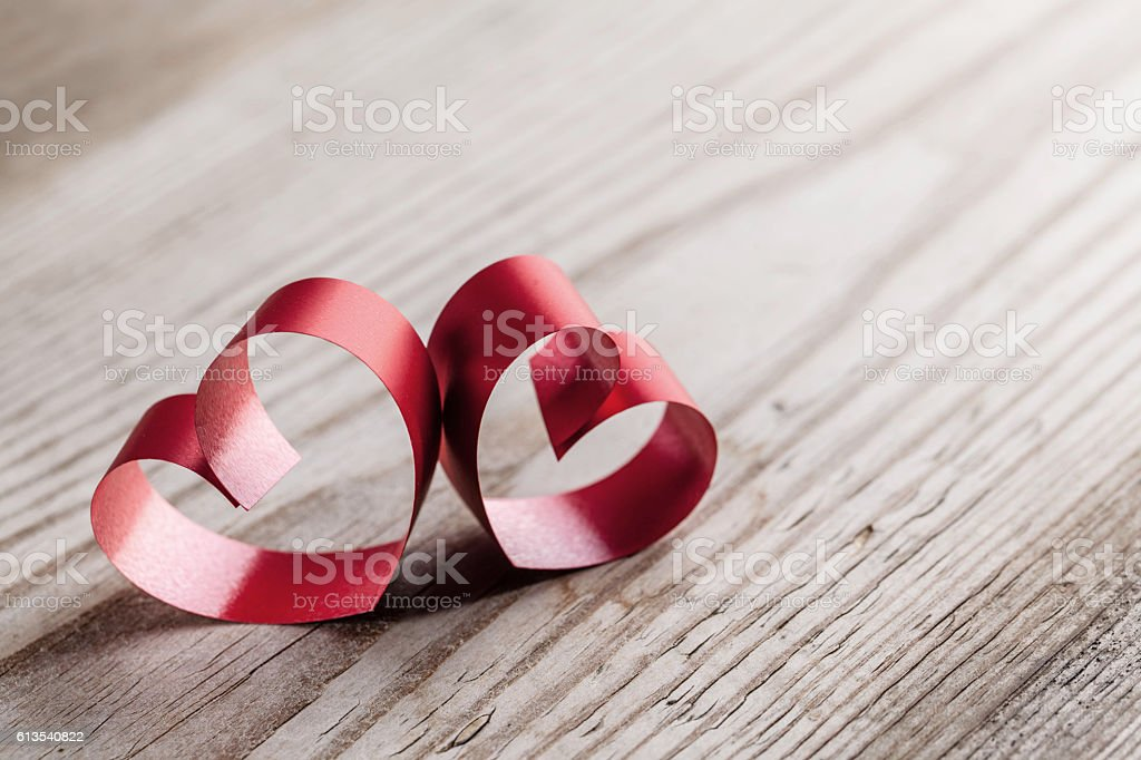 Ribbon hearts on wooden background stock photo