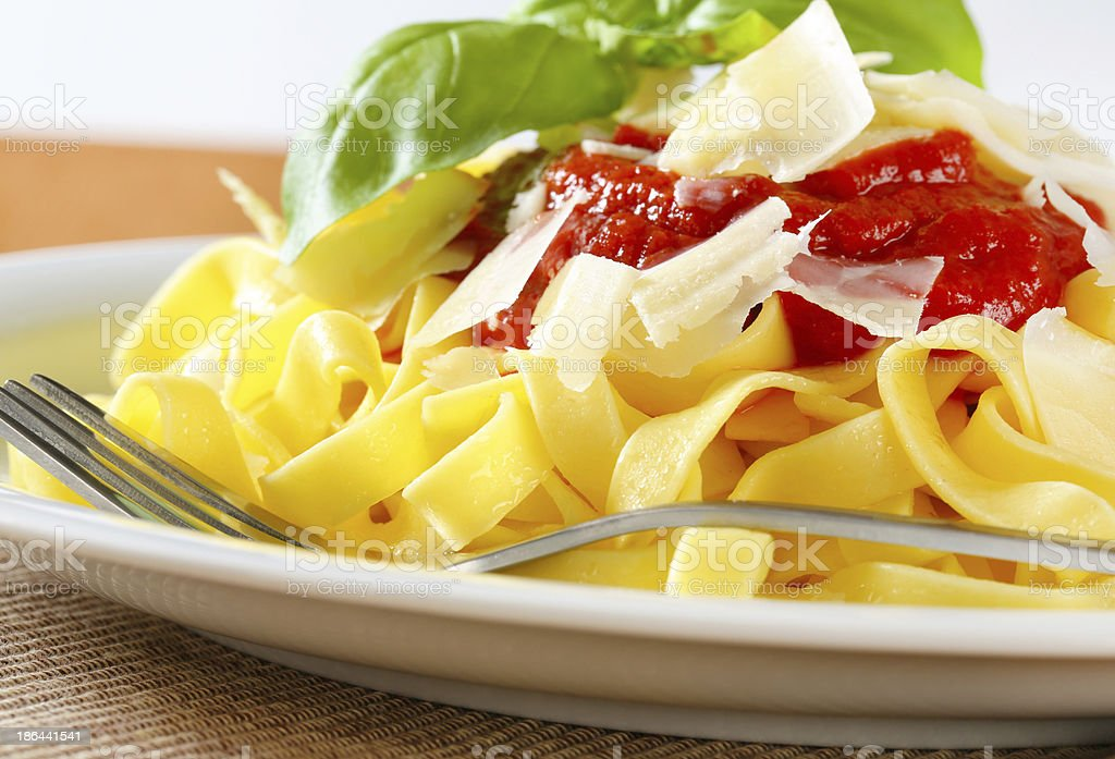 Ribbon pasta with tomato paste and Parmesan royalty-free stock photo