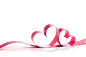 Ribbons shaped as hearts on white