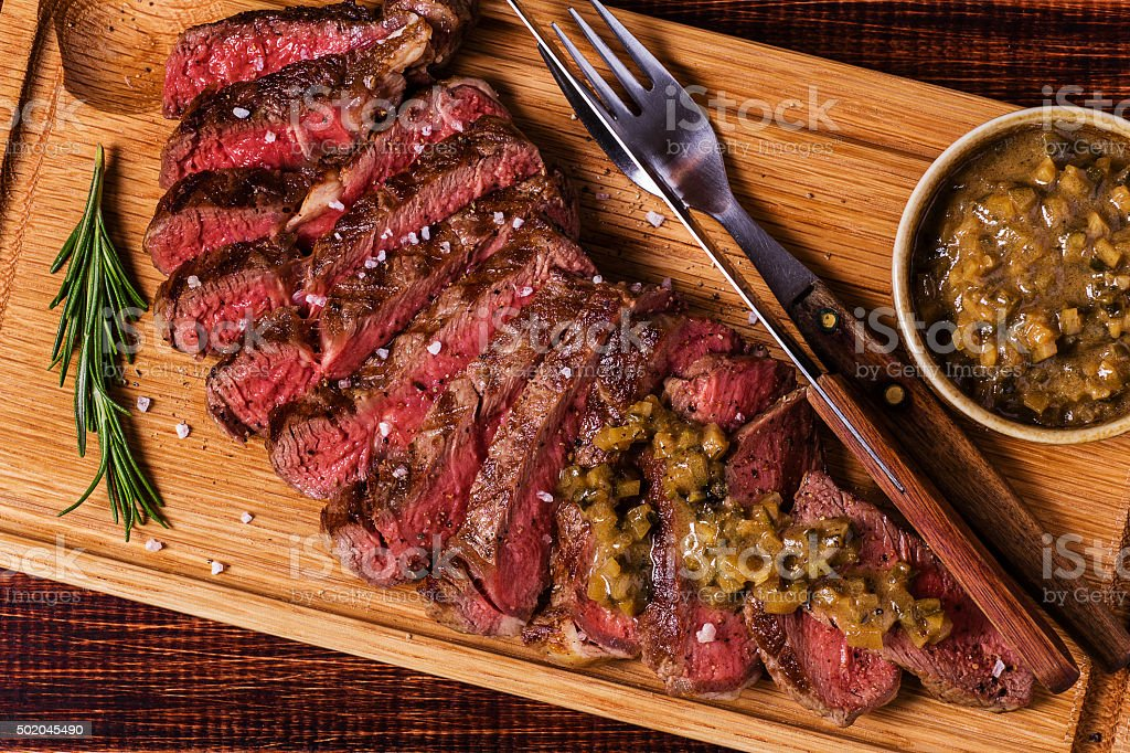 Ribeye steak and mustard sauce with pickles. stock photo