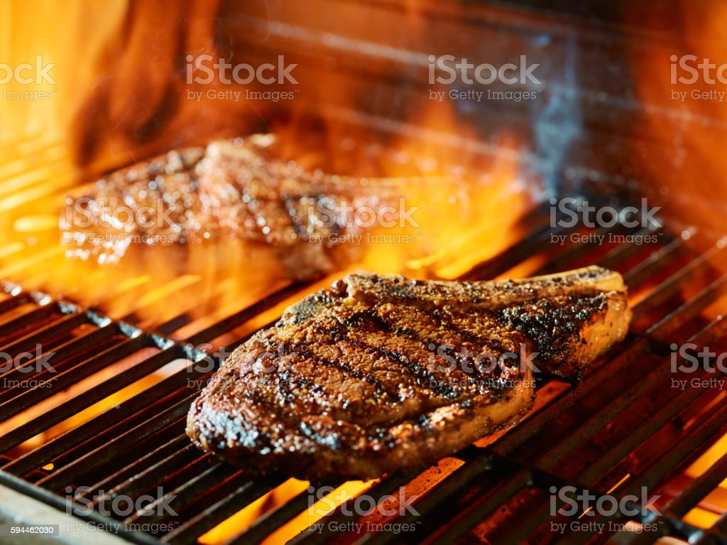 ribeye steak barbecue on the grill stock photo