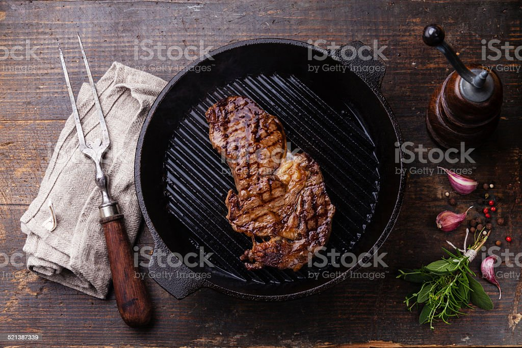 Ribeye steak entrecote on grill pan stock photo