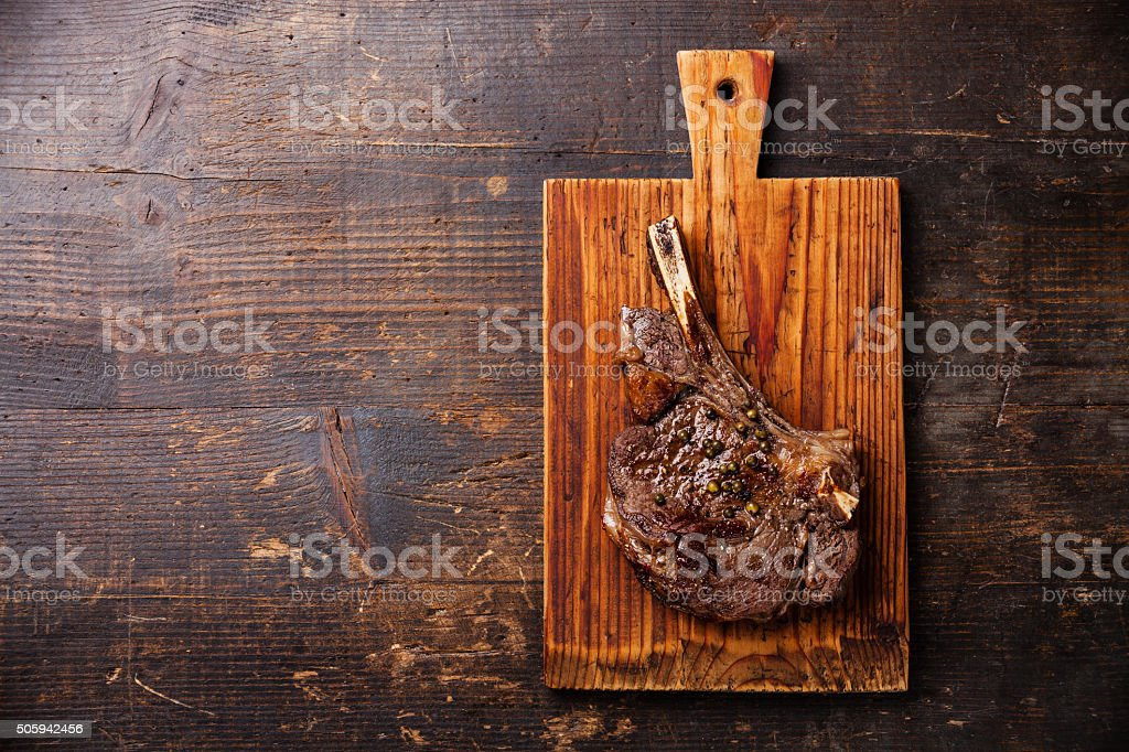 Ribeye Steak on bone stock photo
